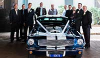 Front view Blue Shelby 1965 Mustang Fastback with groom and groomsmen wedding event Brisbane