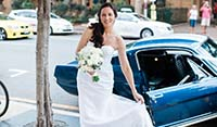 Bride being delivered to the ceremony in a Blue Shelby 1965 Mustang Fastback
