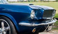 Close up view front Blue Shelby 1965 Mustang Fastback American torque thrust racing wheels