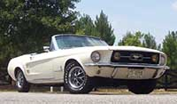 Wimbledon white convertible 1966 Mustang in a country setting